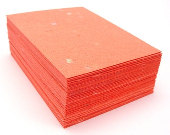 Orange handmade paper cardstock, cut edges, recycled with embedded confetti, 10 small sheets,  4.25 x 5.5 inch