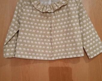 Elephant blouse  and cream skirt set.