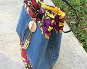 Attention getting sturdy denim bag with African fabric print trim, double pocket on the inside. Cute Jean pocket on the outside