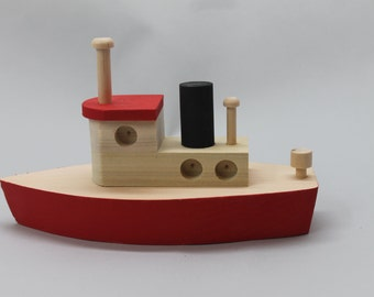 Toy wooden tugboat