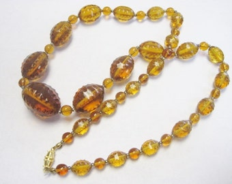Antique Faceted Amber Glass Beads