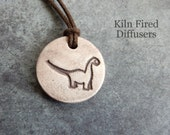 Dinosaur Essential Oil Diffuser Pendant Necklace Kids Small White Clay Aromatherapy Jewelry Natural Hypoallergenic Jurassic Park Pure Oils