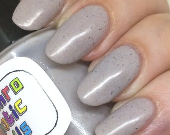 Mudder's Milk Nail Polish - pale oatmeal with metallic flecks