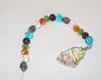Polygon shape crystal wrapped in wire suncatcherwith multi-color crystals.