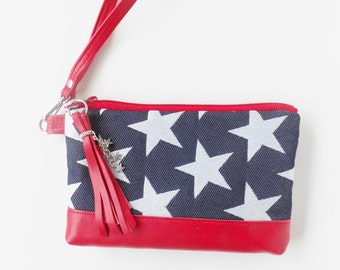 Wristlet or clutch in red, white, and blue  with stars, red leather trim.