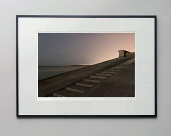 Huddled - a moonlit, long exposure, seascape photograph of Brighton marina, England