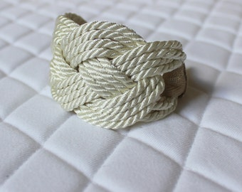 Infinity knot bracelet in cream satin twisted cord with metallic ribbon and gold closure