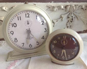 Two wonderful antique chippy white shabby cottage farmhouse clocks