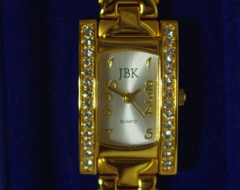 Jackie Kennedy Gold Watch with Crystals,  NEW BATTERY, Box and Certificate