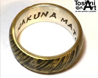 Hakuna Matata ring in sterling silver and brass.