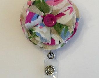 Fabric flower retractable badge clip