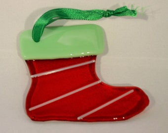 Glass Christmas stocking ornament.