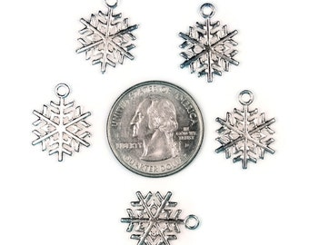 8 Shiny Silver Tone Snowflake Charms - Double Sided