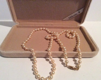 """Mikoshi genuine pearl necklace with velvet box 30"""" long hand knotted in great condition"""