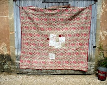 Ancient hand stitched boutis quilt, patched, worn, stitched, faded and darned