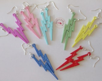 Blue Lightning Bolt Acrylic Earrings dangle on silver hooks. Dark Blue- light blue,red, pink, white