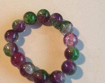 Bracelets. 2 stretch multi colored glass beads