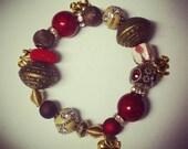 "Arm Candy- ""Devastating Diva "" Handmade Red/Elephant charm bracelet.  DST inspired. Delta Sigma Theta."