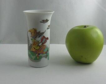 "ROSENTHAL Germany. Small porcelain vase ""Arundo"" with musician with harp. Design: Bjorn Wiinblad. Porcelain vase. H about 10 cm. VINTAGE"
