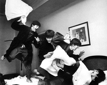 The Beatles having a pillow fight. 1964