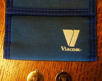 Viacom promotional wallet and two (2) Viacom 10th Anniversary pendants