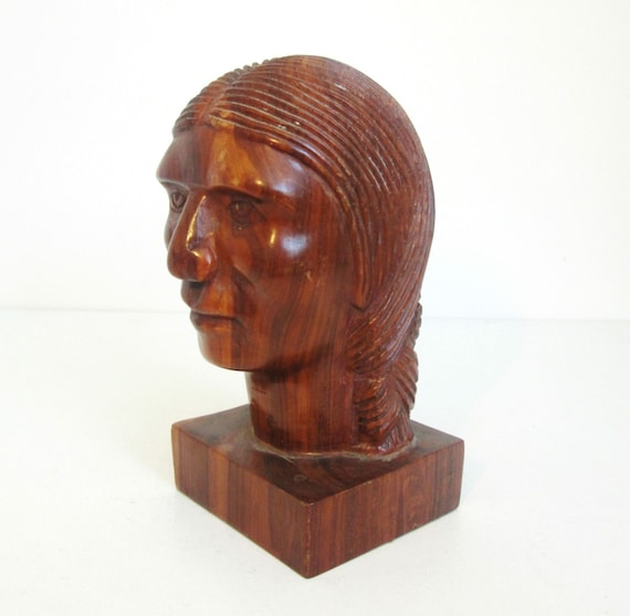 Old wooden carved bust of a native american indian beautiful