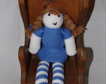 Blue hand knitted doll