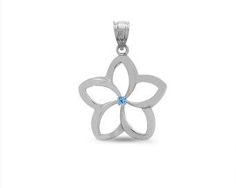 sterling silver genuine blue topaz plumeria pendant. floral pendant.
