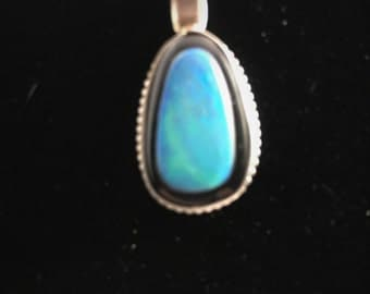 Opal and black onyx pendent in a sterling silver bezel setting on a silver plated chain