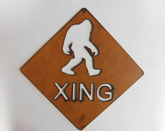 Sasquatch Crossing sign made out of rusted metal