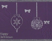 Handmade A5 Purple and Silver Debossed Bauble Merry Christmas Card With Glittered Border in Silver.