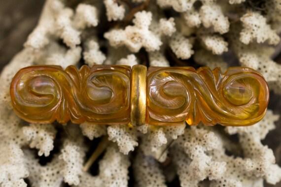 Orange and Gold Carved Bakelite Pin