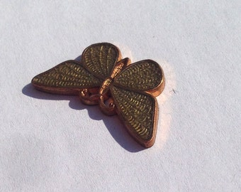 Vintage copper print in shape of buterfly