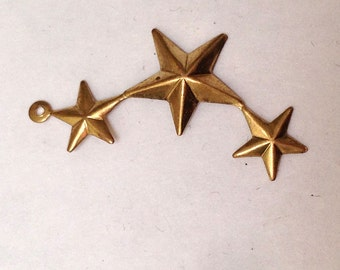 stamp in brass for creation of jewels in the shape of curved baguette decorated with 3 stars and 1 rings