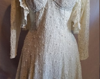 Beautiful cream coloured beaded dress with matching jacket size 12 handmade in Indonesia