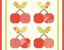 "Mini Cherry Pie by Fig Tree & Co., measures 19"" x 20"""