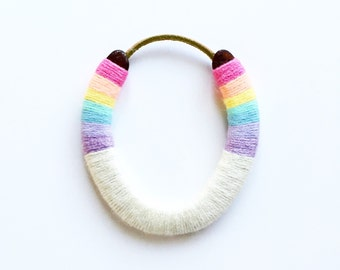 lucky yarn wrapped horseshoe pastel rainbow brite