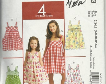 McCall's 5613    Children and Girls Dresses      Size 7,8,10,12,14    uncut