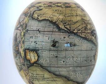 Decoupage World Map ostrich egg: this ostrich eggshell piece has been transformed by skilful decoupage depicting a detailed map of the world