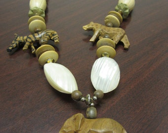 Vintage necklace, African animals, beads, 30 inchs long, great condition, mailed from Canada
