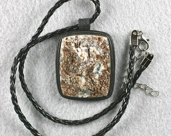 Rough Astrophyllite and leather necklace 40x34mm