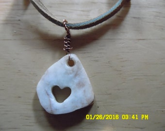 heart carved rock necklace