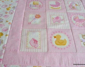 Cot quilt for a baby girl