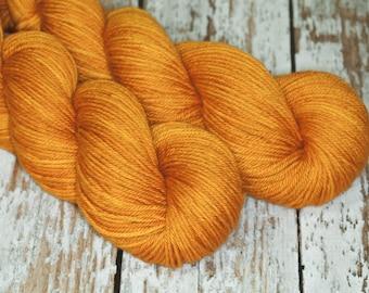 Hand Dyed KM Worsted Superwash Merino Wool Yarn in warm gold