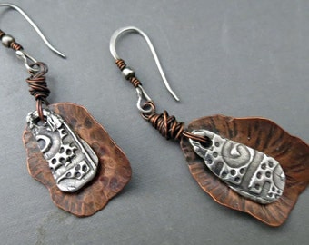 Silver metal clay earrings over copper