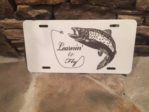 White fly fishing license plate for Fishing license il