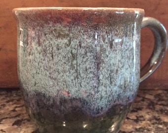 Glazed mug in purple ,green, and white