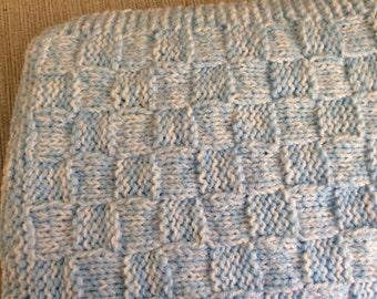 Blueand white  knitted pram blanket.
