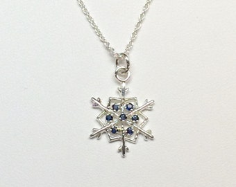 Sterling silver Bitthstone snowflake pendant.