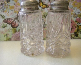 Salt and Pepper shakers  1930's cut glass  pewter tops